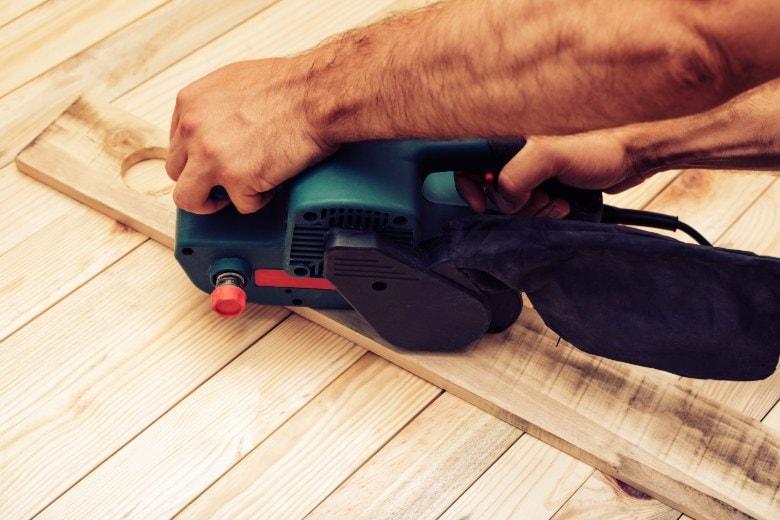 Sanding with a belt sander